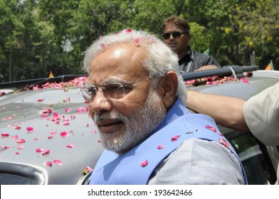 NEW DELHI-MAY 17: Indian Prime Minister Narendra Modi surrounded by his bodyguards during a roadshow  after wining the Indian National election on May 17, 2014 in New Delhi , India.