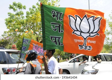 NEW DELHI-MAY 17: Supporters carrying a BJP flag on motorbike after wining the Indian National election on May 17, 2014 in New Delhi , India.