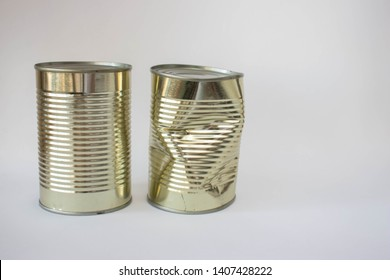 A new and a dented can on a white background