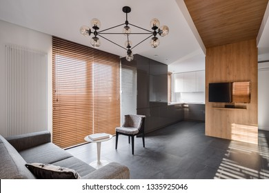 New design apartment with wooden blinds and decorative ceiling lamp
