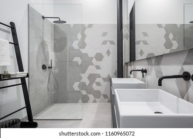 New design bathroom with shower and two basins, in gray and white with black details