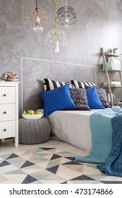 New design bedroom with pattern carpet, large bed and decorative wall plaster