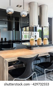 New design black open kitchen and dining room combined