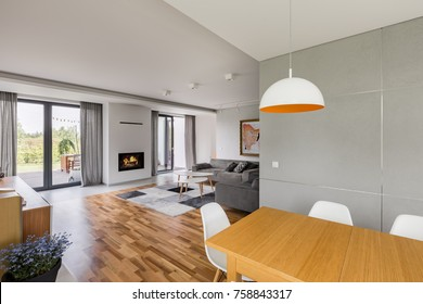 New design home interior with wooden table and spacious living room