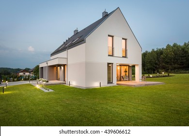 New design light house with wide lawn and decorative outdoor lighting, external view