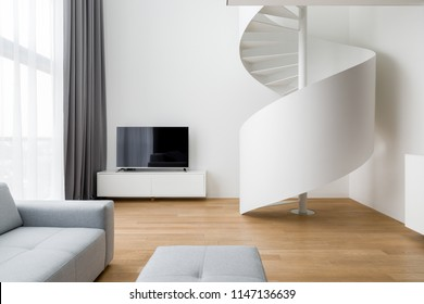 New design tv living room with white, spiral stairway
