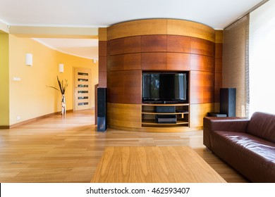 New design tv living room in brown with sofa, small table and wooden floor panels
