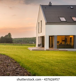New design white villa with wide, perfect lawn,external view