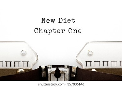 New Diet Chapter One printed on retro typewriter.