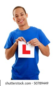 New driver ripping learner plate isolated on white