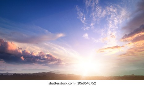 New earth and heaven concept: Sun light and early morning mountain sky background