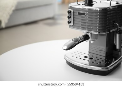 New electric coffee maker on table