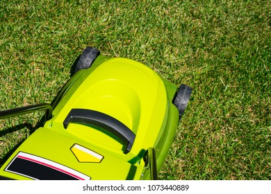 New electrical lawn mover on grass with nobody