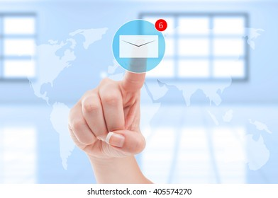 New emails inbox futuristic concept with finger pressing digital envelope on transparent digital display screen