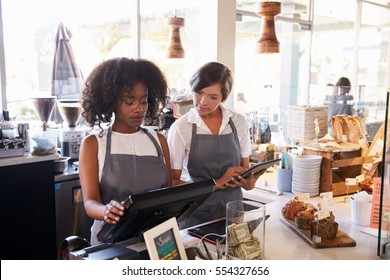 New Employee Receives Training At Delicatessen Checkout