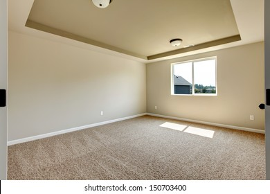New empty room with beige carpet.. New house development in USA.