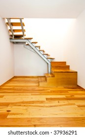 New empty stairway room with hardwood floor