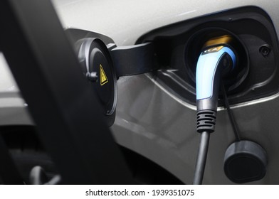 New energy Is electric power for cars Charging a new battery Future car transportation.