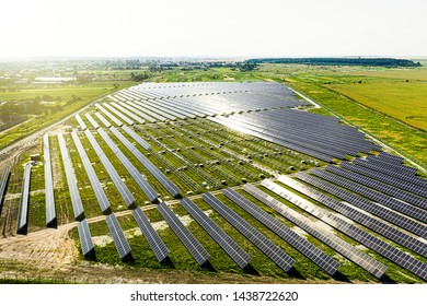 New energy. Solar panels in aerial view. Pepairing solar panel at generating power of solar power plant.