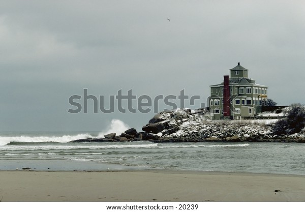 New England beach front home in the winter