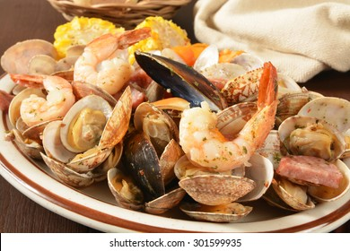 New England style clam bake with shrimp, mussels, corn and potatoes