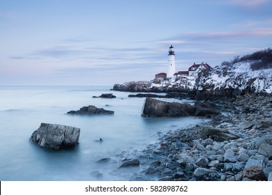 New England's iconic Portland Head Lighthouse in winter