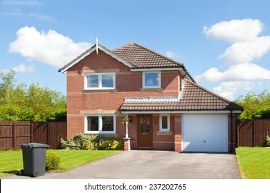 New english detached house with garage and garden