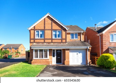 New english detached house in sunny day