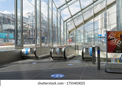 New entrance to Tottenham Court Road Station with glass canopy covering escalators down to station. London - 13th June 2020