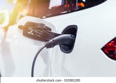 New era of vehicle fuel. Power charging of white modern electric car