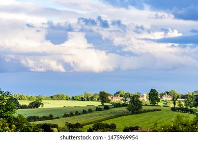 new estate village in england with cloudy sky on sunny evening