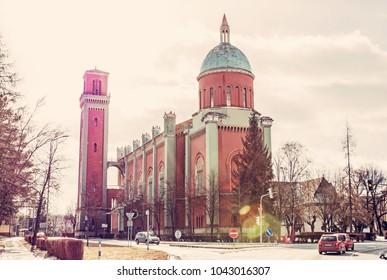 New evangelical church in backlight, Kezmarok, Slovak republic. Religious architecture. Travel destination. Retro photo filter.