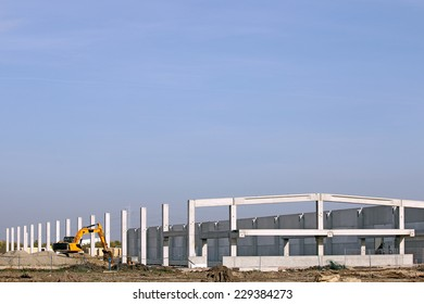 new factory construction site with excavator