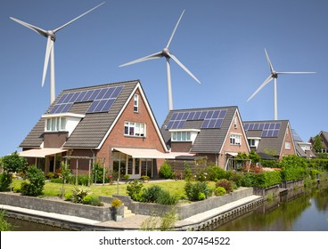 New family homes with solar panels and wind turbines