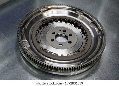 New flywheel on a steel background.  Details of the modern car.