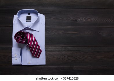 new folded business blue shirt and red tie. Man's formal wearing