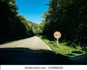 New French 80kmph speed limit sing seen on a public road in forest. As of July 1, 2018 the speed limit on two lane roads from 90 KMPH to 80 KMPH, in the hope addressing alarming rise in number of road