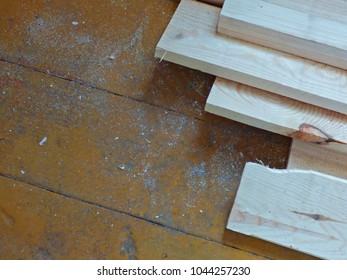 New fresh boards on aged wooden surface (floor or table). Abstract background. Natural materials - two kinds of wood.