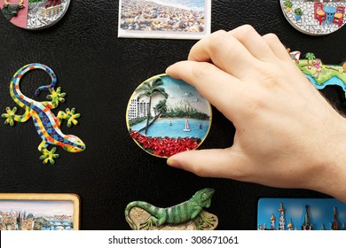 A new fridge magnet from the last vacation (travel concept)