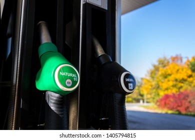 New fuel labeling at petrol station pumps with new EU labels, sunny day