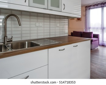 New furnished apartment, small, white kitchen with window.