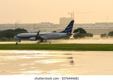 New Gen Airways Boeing 737, registration HS-NGH, named Fang Wang, takes off from a wet runway of Donmueang International Airport (DMKVTBD), Bangkok, Thailand, on 12 September 2017.