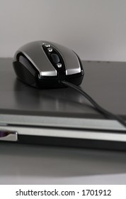 The new generation mouse that look like a racing car on a silver laptop