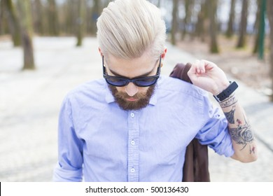 New generation style represented by blond hipster guy.