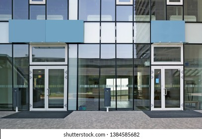 New glass windows and doors of a modern office building panoramic outdoor shot