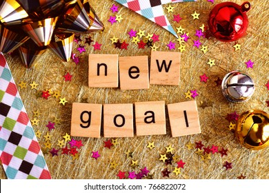 New goal wooden blocks. New year is the first day of the year in the Gregorian calendar.
