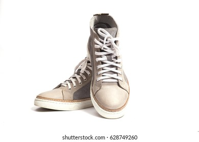 new gray sneakers isolated on white background.