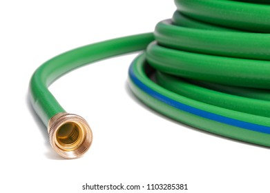 New green garden hose isolated on a white background