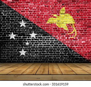 New Guinea flag painted on brick wall with wooden floor