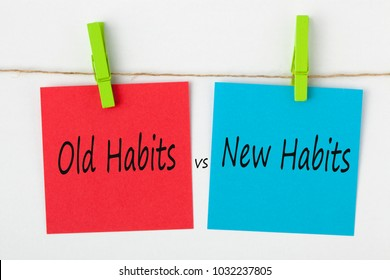 New Habits vs Old Habits written on note paper with wooden pinch on white background. Business concept words.